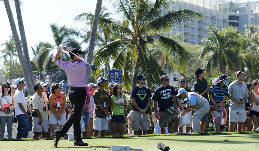 Jimmy Walker drives off the 12th tee box during the final round of the Sony Open golf tournament, Sunday, Jan. 18, 2015, in Honolulu. (AP Photo/Hugh Gentry)