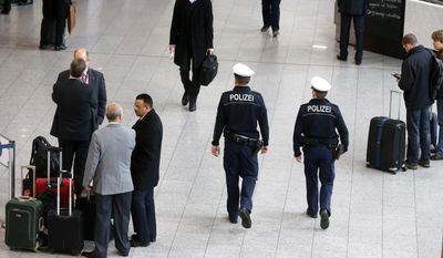 German police officers patrol in a terminal at the airport in Frankfurt, Germany, Monday, Jan. 19, 2015. (AP Photo/Michael Probst) ** FILE **