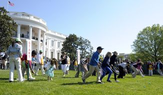 Children participate in the annual White House Easter Egg Roll on the South Lawn of the White House in Washington, Monday, April 9, 2012. (AP Photo/Susan Walsh)