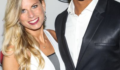 Seattle Seahawks QB Russell Wilson and wife Ashton Meem at the Body at ESPYS Party sponsored by Hennessy V.S on July 16, 2013 at Lure in Los Angeles, CA. (Photo by Paul A. Hebert/Invision for Hennessy/AP Images)