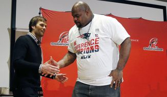 New England Patriots quarterback Tom Brady, left, shakes hands with defensive lineman Vince Wilfork during a press conference after the NFL football AFC Championship game against the Indianapolis Colts Sunday, Jan. 18, 2015, in Foxborough, Mass. The Patriots defeated the Colts 45-7 to advance to the Super Bowl against the Seattle Seahawks. (AP Photo/Elise Amendola)