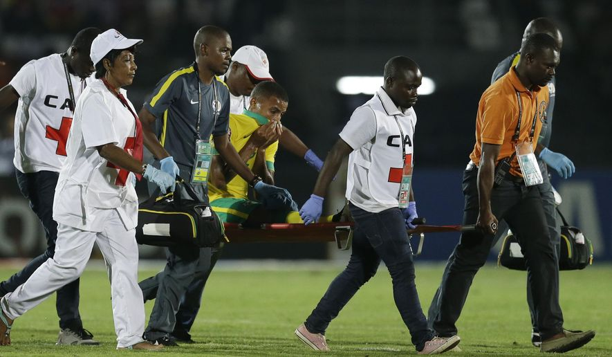 South Africa's Rivaldo Coetzee, is carried out of the field on a stretcher during the African Cup of Nations Group C soccer match against Algeria in Mongomo, Equatorial Guinea, Monday, Jan. 19, 2015. (AP Photo/Themba Hadebe)