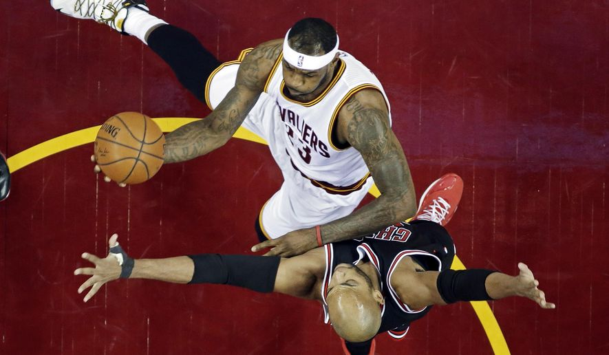 Cleveland Cavaliers' LeBron James (23) shoots against Chicago Bulls' Taj Gibson in the first half of an NBA basketball game Monday, Jan. 19, 2015, in Cleveland. (AP Photo/Mark Duncan)