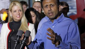 FILE - In this Nov. 3, 2014, file photo, Louisiana Gov. Bobby Jindal delivers a speech for Florida Gov. Rick Scott in Clearwater, Fla. Some countries have allowed Muslims to establish autonomous neighborhoods in cities where they govern by a harsh version of Islamic law, Jindal said Monday, Jan. 19, 2015, during a speech in London. (AP Photo/Chris O'Meara, File)