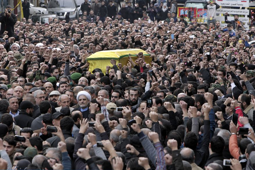 "Hezbollah fighters carry the coffin of Jihad Mughniyeh, the son of Imad Mughniyeh, a top Hezbollah operative assassinated in 2008 in Damascus and one of the six Hezbollah fighters killed in what the group said was an Israeli airstrike Sunday in the Golan, during his funeral procession, in southern Beirut, Lebanon, Monday, Jan. 19, 2015. Jihad Mughniyeh is the Hezbollah's most prominent figure to die so far in Syria since the Shiite militant group joined the conflict next door in 2012, fighting on Assad's side against the Sunni-led rebellion. Thousands of supporters pumped their fists angrily in the air and chanted, ""Death to Israel."" (AP Photo/Bilal Hussein)"