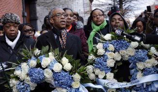 The Rev. Al Sharpton, center, arrives with Eric Garner's mother Gwen Carr, left, his widow Esaw, center behind Sharpton, and daughter Erica, second from right, to lay a wreath at the site where Officers Wenjian Liu and Rafael Ramos were killed, Monday, Jan. 19, 2015, in New York. (AP Photo/Mary Altaffer) ** FILE **