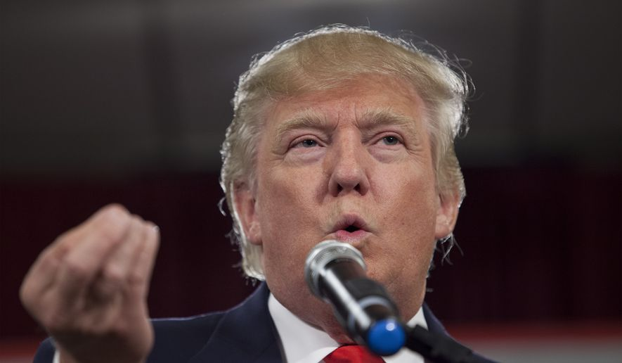 Donald Trump makes his keynote address on Monday, Jan. 19, 2015, at the South Carolina Tea Party Coalition Convention in Myrtle Beach, S.C.  (AP Photo/Randall Hill)
