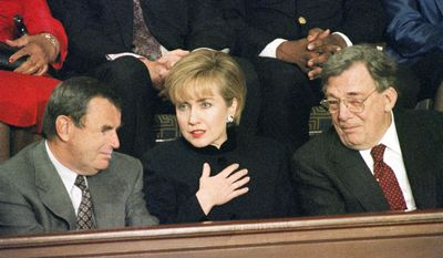 First lady Hillary Rodham Clinton speaks with Jack Smith, CEO of General Motors, left, and Lane Kirkland, president of the AFL-CIO, before President Bill Clinton's State of the Union speech on Capitol Hill in Washington on Jan. 25, 1994. (AP Photo/Doug Mills)