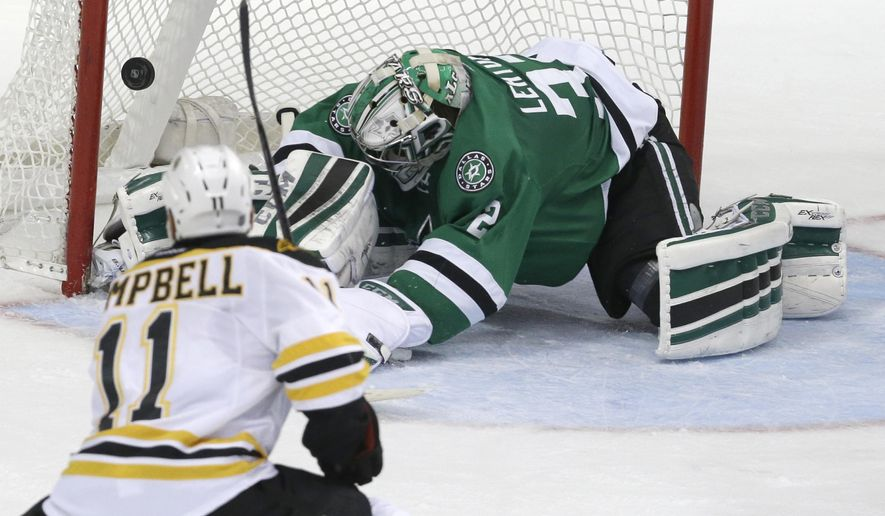 Boston Bruins center Gregory Campbell (11) scores a goal against Dallas Stars goalie Kari Lehtonen (32) during the second period of an NHL hockey game Tuesday, Jan. 20, 2015, in Dallas. (AP Photo/LM Otero)