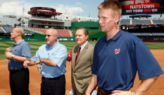 Sports agent Scott Boras (second from right) once predicted players would want to play in D.C. Boras has made several deals with Nationals general manager Mike Rizzo (second from left), including pitcher Stephen Strasburg (right), and Max Scherzer. (Associated Press)