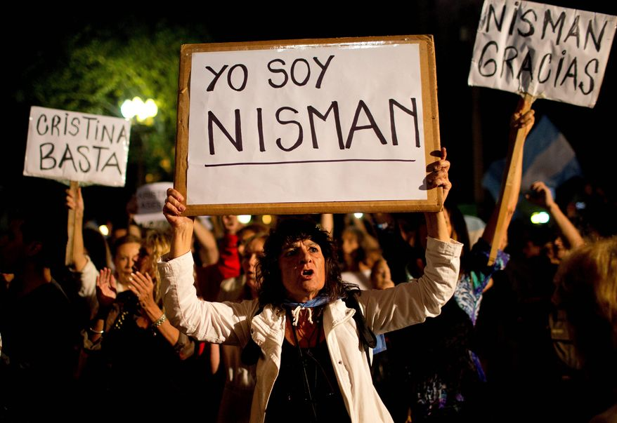 "A demonstrator holds a sign that reads ""I am Nisman"" in Spanish during a protest sparked by the death of special prosecutor Alberto Nisman in Buenos Aires, Argentina. (Associated Press)"