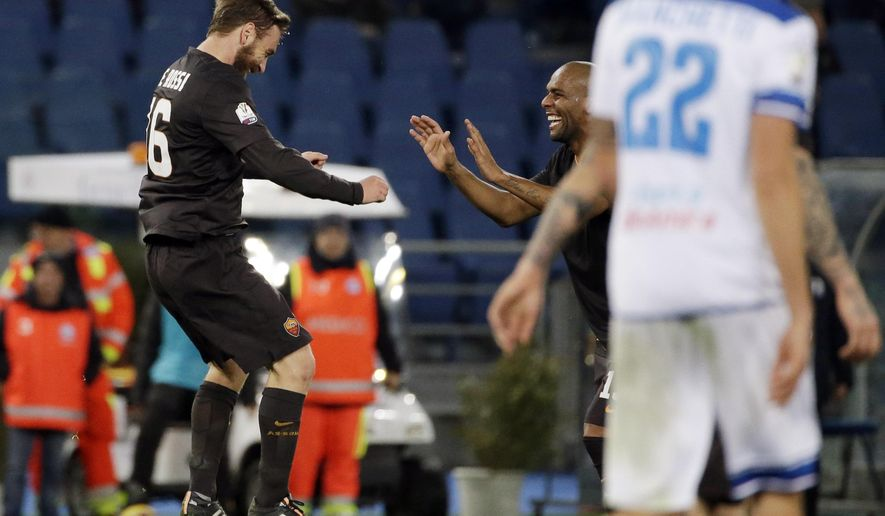 Roma's Daniele De Rossi, left, celebrates with his teammates after scoring on penalty during an Italian Cup soccer match between Roma and Empoli at Rome's Olympic Stadium, Tuesday, Jan. 20, 2015. (AP Photo/Andrew Medichini)