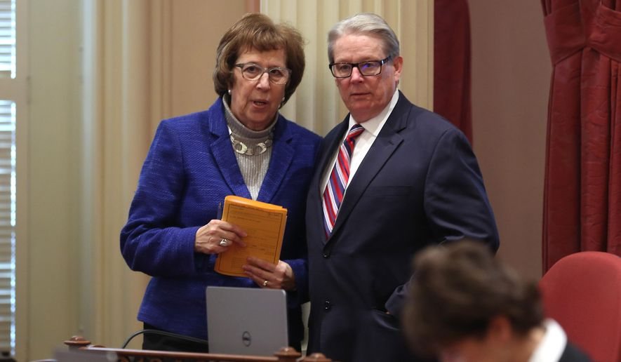 Sen. Lois Wolk, left, D-Davis and Sen. Bill Monning, D-Carmel, who have coauthored right-to-die legislation, stand together during the Senate session at the Capitol in Sacramento, Calif., Tuesday, Jan. 20, 2015. The measure was inspired by the case of Brittany Maynard, a 29-year-old San Francisco Bay Area woman who moved to Oregon where she could legally end her life. The lawmakers will introduce the legislation, with members of Maynard's family, at a Capitol news conference, Wednesday, Jan. 21. (AP Photo/Rich Pedroncelli)