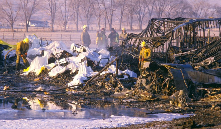 FILE - In this Jan. 21, 1985, file photo, firefighters continue to water down the wreckage of the Galaxy Airliner that crashed shortly after 1 a.m., killing all but one person aboard in Reno, Nev.  George Lamson, Jr, 17, of St. Paul, Minn., the lone survivor that killed 70 people on a Super Bowl junket in 1985 says he can't bring himself to attend a rededication ceremony for a memorial plaque honoring the victims on the 30th anniversary of the tragedy. Washoe County officials plan to unveil a new plaque Wednesday, Jan. 21, 2015, after the original was stolen two years ago from a regional park near the campus of the University of Nevada, Reno. (AP Photo/Reno Gazette-Journal, Marilyn Newton, File)