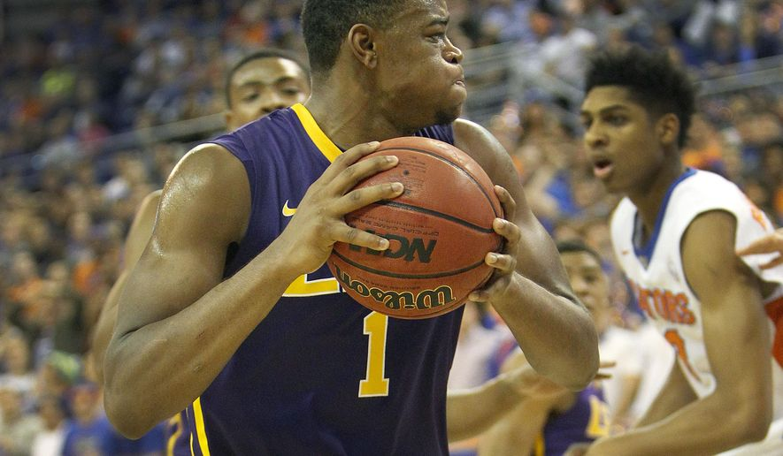 LSU forward Jarell Martin (1) grabs a rebound against Florida during the second half of an NCAA college basketball game Tuesday, Jan. 20, 2015, in Gainesville, Fla. LSU defeated Florida 79-61. (AP Photo/The Gainesville Sun, Matt Stamey)