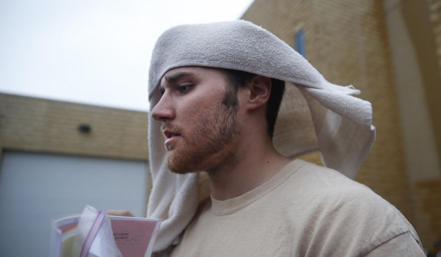 FILE - In this May 12, 2014, file photo,  former Minnesota quarterback Philip Nelson leaves jail in Mankato, Minn., with a towel on his head after posting bail.  Nelson has agreed to plead guilty to a misdemeanor charge stemming from a fight that left another former football player with a serious brain injury, his attorney said, Tuesday, Jan. 20, 2015. (AP Photo/The Star Tribune, Richard Tsong-Taatarii, File)  MANDATORY CREDIT; ST. PAUL PIONEER PRESS OUT; MAGS OUT; TWIN CITIES TV OUT
