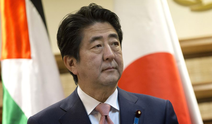 Japanese Prime Minister Shinzo Abe attends a joint press conference with Palestinian President Mahmoud Abbas at the Palestinian Authority headquarters, in the West Bank city of Ramallah, Tuesday, Jan. 20, 2015. An online video released Tuesday purported to show the Islamic State group threatening to kill two Japanese hostages unless they receive a $200 million ransom in the next 72 hours. (AP Photo/Nasser Nasser)