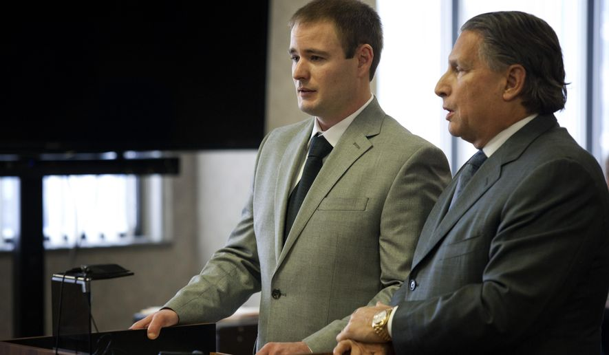 Brandon Verfaillie, left, of Chesterfield Township, stands next to his lawyer, James Thomas, during his sentencing at the St. Clair County Courthouse, Tuesday, Jan. 20, 2015, in Port Huron, Mich. Verfaillie was sentenced to at least five years in prison for a boat crash that killed two people near Harsens Island in eastern Michigan. (AP Photo/The Port Huron Times Herald, Jeffrey M. Smith)  NO SALES