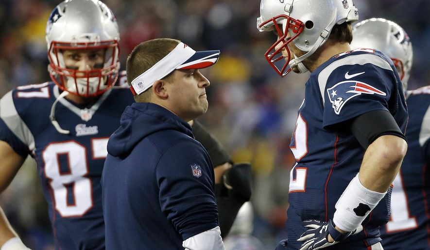 New England Patriots offensive coordinator Josh McDaniels, center, talks to quarterback Tom Brady, right, before the NFL football AFC Championship game between the Patriots and Indianapolis Colts Sunday, Jan. 18, 2015, in Foxborough, Mass. (AP Photo/Elise Amendola)