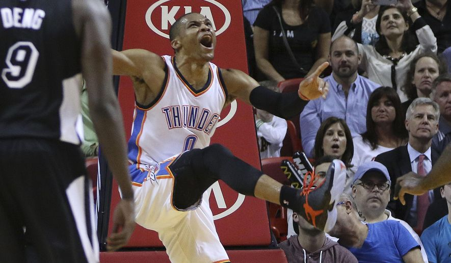 Oklahoma City Thunder's Russell Westbrook (0) reacts after scoring against the Mia;mi Heat during the first half of an NBA basketball game in Miami, Tuesday, Jan. 20, 2015. (AP Photo/J Pat Carter)