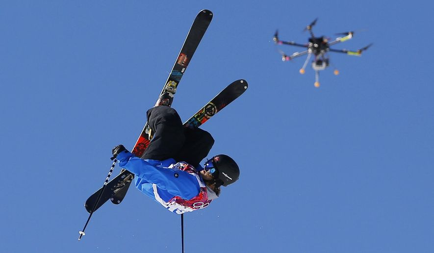 FILE- In this Feb. 13, 2014, file photo, a drone camera follows Norway's Aleksander Aurdal during the men's ski slopestyle final at the Rosa Khutor Extreme Park, at the 2014 Winter Olympics in Krasnaya Polyana, Russia. The Winter X Games is, for the first time, using drones, to enhance its coverage this year. (AP Photo/Sergei Grits, File)