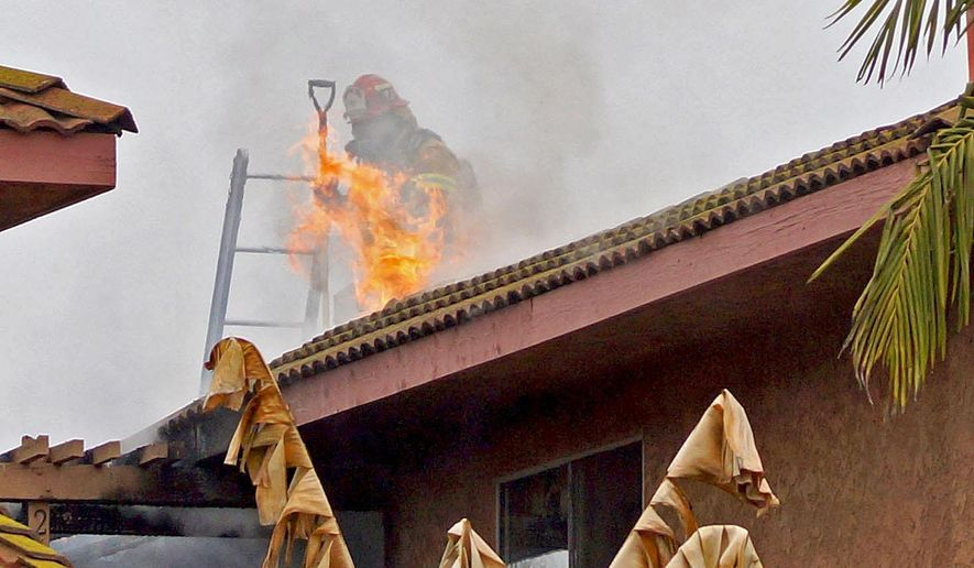 Firefighters fight a blaze at an condominium complex in the 26000 block of La Zanja Street in San Juan Capistrano, Calif., Tuesday, Jan. 20, 2015. Southern California authorities say eight people were rushed to local hospitals with burns, smoke inhalation and other injuries after the apartment fire. (AP Photo/The Orange County Register, Fred Swegles)   MAGS OUT; LOS ANGELES TIMES OUT