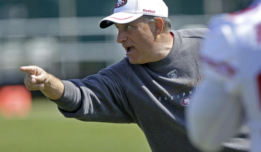 FILE - In this July 30, 2011, file photo, San Francisco 49ers defensive coordinator Vic Fangio gestures during NFL football training camp in Santa Clara, Calif. The former San Francisco 49ers defensive coordinator has taken the same job with the Chicago Bears under new coach John Fox, a person with knowledge of the deal said, Tuesday, Jan. 20, 2015.   (AP Photo/Ben Margot, File)