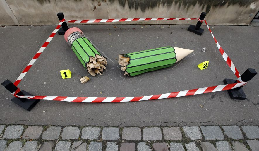 "An anonymous art installation showing a broken pencil is displayed on the pavement near the Charlie Hebdo office in Paris, Tuesday, Jan. 20, 2015. Terror attacks by French Islamic extremists should force the country to look inward at its ""ethnic apartheid,"" the prime minister said Tuesday as four men faced preliminary charges on suspicion of links to one of the gunmen. (AP Photo/Francois Mori)"