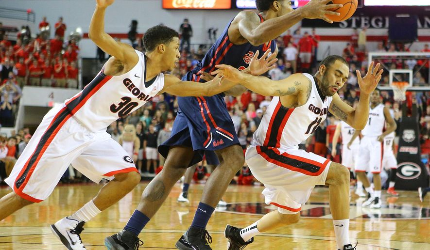 Mississippi orward Aaron Jones comes up with a loose ball for a steal between Georgia guard J.J. Frazier, left, and forward Cameron Forte during the first half of an NCAA college basketball game Tuesday, Jan. 20, 2015, in Athens, Ga. (AP Photo/Atlanta Journal Constitution, Curtis Compton)