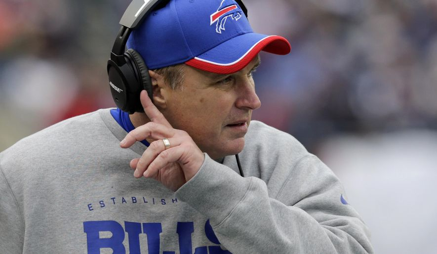 FILE - In this Dec. 28, 2014, file photo, then-Buffalo Bills head coach Doug Marrone watches from the sideline during the first half of an NFL football game against the New England Patriots in Foxborough, Mass. The Jacksonville Jaguars hired the former Bills coach on Tuesday, Jan. 20, 2015, as assistant head coach and offensive line coach. (AP Photo/Charles Krupa, File)