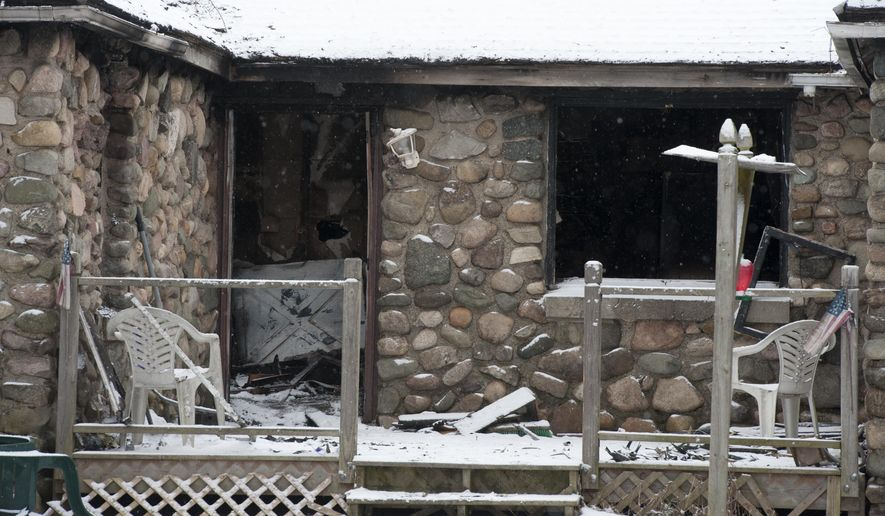Fire damage to a home at 9456 Churchill Road in Rives Township is shown  on Tuesday, Jan. 20, 2015. One man was killed in the Monday fire. Police say the man was found dead in his home after the fire was extinguished. (AP Photo/The Jackson Citizen Patriot, J. Scott Park) ALL LOCAL TELEVISION OUT; LOCAL TELEVISION INTERNET OUT