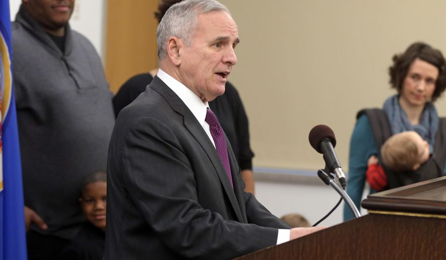 Gov. Mark Dayton announces his proposal to expand the Child and Dependent Care Credit, Tuesday, Jan. 20, 2015, in St. Paul, Minn. Dayton's plan would provide $101 million in direct tax relief to 130,000 low-and middle-income families. (AP Photo/Jim Mone)