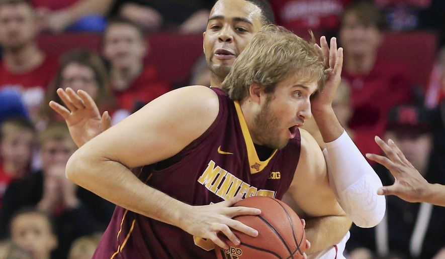 Minnesota's Elliott Eliason (55) is defended by Nebraska's Walter Pitchford, rear, during the first half of an NCAA college basketball game in Lincoln, Neb., Tuesday, Jan. 20, 2015. (AP Photo/Nati Harnik)