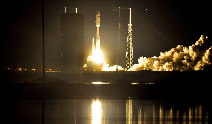 The Air Force launches an unmanned Atlas V (five) rocket Tuesday, Jan. 20, 2015, from Cape Canaveral, Fla. The rocket hoisted the third in a series of Mobile and User Objective System satellites. (AP Photo/Florida Today, Craig Rubadoux)  NO SALES