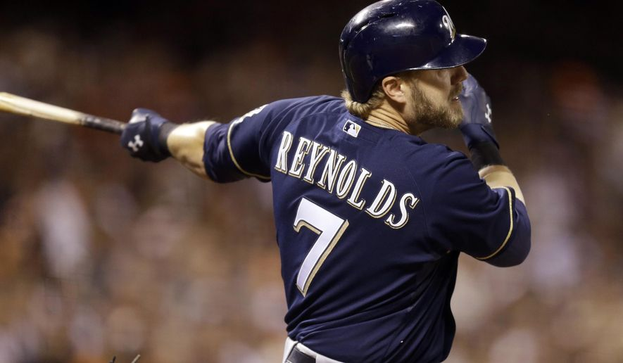 FILE - In this Aug. 30, 2014, file photo, Milwaukee Brewers' Mark Reynolds hits a single off San Francisco Giants' Jake Peavy in the eighth inning of a baseball game in San Francisco. Reynolds, a free agent, signed with the St.  Louis Cardinals this offseason. The Cardinals' are prepared to live with the swings and misses, knowing when Reynolds connects the ball really travels. They've lacked a power bat off the bench and Reynolds also could platoon with Matt Adams at first base (AP Photo/Ben Margot, File)