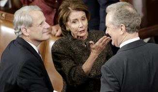 House Minority Leader Nancy Pelosi of Calif., center, talks with Rep. Steve Israel, D-N.Y., left, and Rep. Chris Van Hollen, D-Md.,  on Capitol Hill in Washington, Tuesday, Jan. 20, 2015,  before President Barack Obama's State of the Union address before a joint session of Congress.  (AP Photo/Pablo Martinez Monsivais)