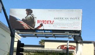 """An """"American Sniper"""" billboard on Wilshire Boulevard and Bundy Drive in Los Angeles was defaced with the word """"Murder!"""" in red paint on Sunday. (My Fox Philly)"""