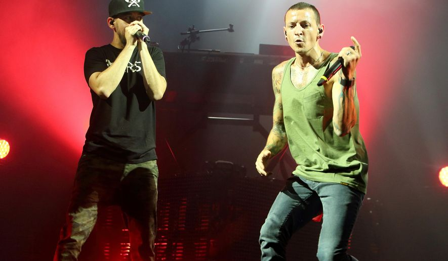 "FILE - In this Aug. 15, 2014 file photo, Mike Shinoda, left, and Chester Bennington of the band Linkin Park perform in concert during their ""Carnivores Tour 2014"" at the Susquehanna Bank Center in Camden, N.J. Linkin Park is canceling the rest of its U.S. tour after its lead singer injured his leg. Bennington says in a statement Tuesday, Jan. 20, 2015, that he needs immediate medical attention and that it is impossible for him to perform.  (Photo by Owen Sweeney/Invision/AP, File)"