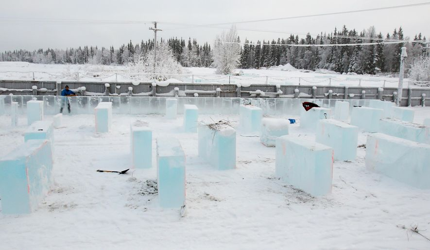 Ice blocks are lined out for the Kids Park Maze as work begins on this year's Ice Alaska Ice Park in Fairbanks, Alaska Monday, Jan. 19, 2015 in preparation for the 2015 BP World Ice Art Championships. The park opens Feb. 23. (AP Photo/Fairbanks Daily News-Miner, Eric Engman)