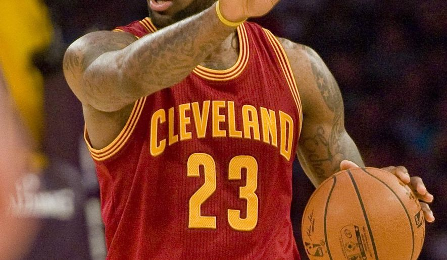 Cleveland Cavaliers forward LeBron James directs his teammates late in the fourth period against the Lakers in Thursday's game Jan. 15, 2015. (AP Photo/The Orange County Register, Paul Rodriguez)