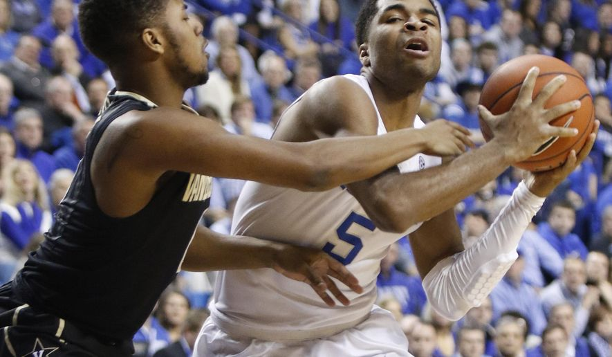 Kentucky's Andrew Harrison, right, is fouled by Vanderbilt's Shelton Mitchell during the first half of an NCAA college basketball game in Lexington, Ky., Tuesday, Jan. 20, 2015. (AP Photo/James Crisp)
