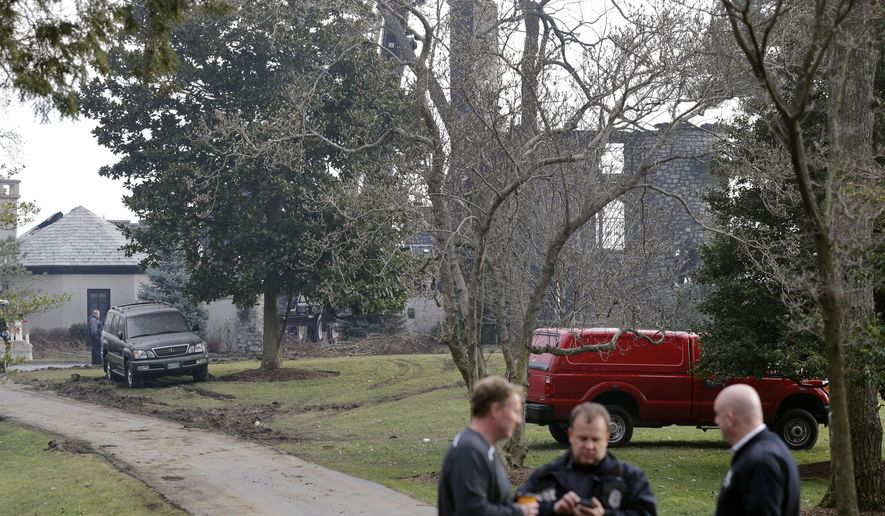 A waterfront mansion's walls remain standing after much of the structure was gutted Monday by a massive fire, Tuesday, Jan. 20, 2015, in Annapolis, Md. Relatives of six family members who remain unaccounted for after the fire believe they were inside at the time of Monday's blaze, a fire official said Tuesday. (AP Photo/Patrick Semansky) **FILE**