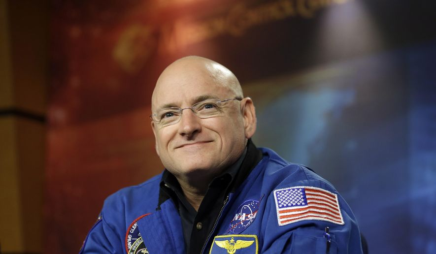 FILE - In this Dec. 5, 2012 file photo NASA astronaut Scott Kelly listens to a question during a briefing at Johnson Space Center in Houston. Kelly is a guest to watch President Barack Obama's State of the Union address on Capitol Hill Tuesday.  (AP Photo/David J. Phillip, File)