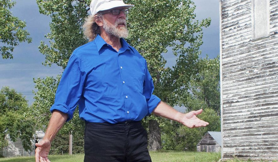 FILE - In this Aug. 26, 2013 file photo, white supremacist Craig Cobb stands in an empty lot he owned in Leith, N.D. Two New York filmmakers have a documentary competing at this year's Sundance Film Festival beginning Jan. 22, 2015, in Park City, Utah, about what happened when Cobb tried to take over the small North Dakota town. Ryan Schock, the mayor of Leith, is scheduled to attend the premiere, and Cobb plans to be available to the festival to answer questions by video conference. (AP Photo/Kevin Cederstrom, File)