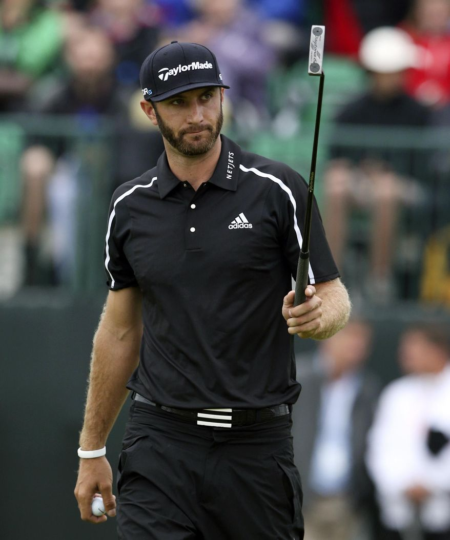 """FILE - In this July 19, 2014, file photo,Dustin Johnson acknowledges the gallery after holing his putt on the first green during the third day of the British Open Golf championship at the Royal Liverpool golf club, Hoylake, England. Johnson says in a magazine interview that cocaine is not the reason he chose to sit out the last six months to get his life in order. Johnson said in August that he was taking a leave of absence from the PGA Tour to seek professional help for what he called """"personal challenges.""""   (AP Photo/Jon Super, File)"""