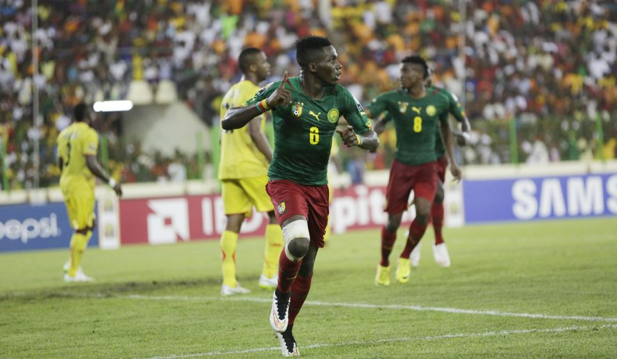 Cameroon's Ambroise Oyongo, celebrates after scoring a goal against Mali, during their African Cup of Nations Group D soccer match in Estadio De Malabo, Equatorial Guinea, Tuesday Jan. 20, 2015. (AP Photo/Sunday Alamba)