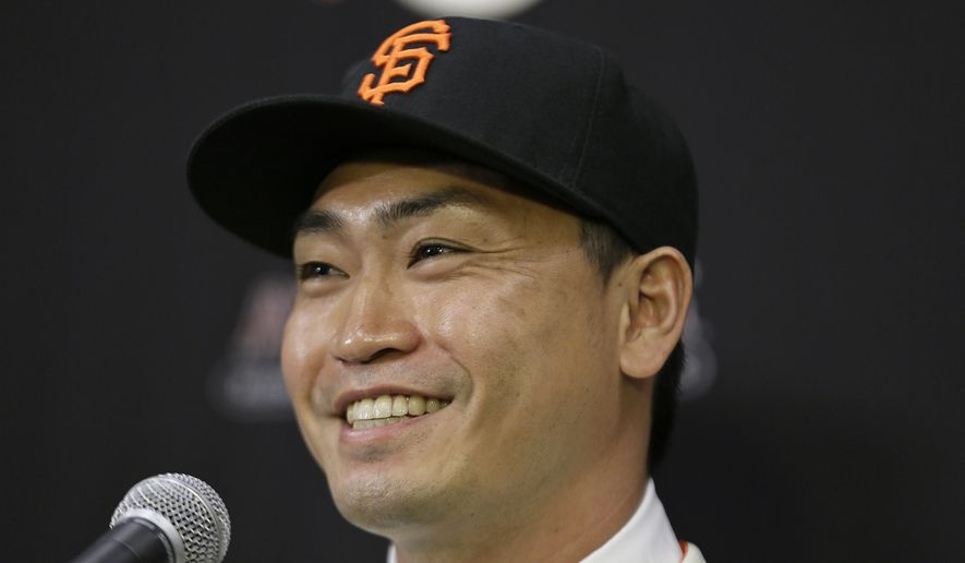 San Francisco Giants outfielder Nori Aoki, of Japan, smiles after being introduced at a baseball news conference at AT&T Park Tuesday, Jan. 20, 2015, in San Francisco. The 33-year-old from Japan receives a $4 million base salary this year, and the Giants have a $5.5 million option for 2016 with a $700,000 buyout. Aoki played last season with Kansas City, which lost the World Series to the Giants in seven games. (AP Photo/Eric Risberg)