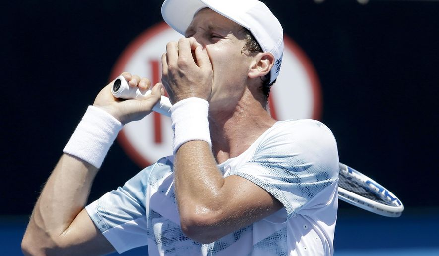 Tomas Berdych of the Czech Republic reacts to a lost point to Jurgen Melzer of Austria during their second round match at the Australian Open tennis championship in Melbourne, Australia, Wednesday, Jan. 21, 2015. (AP Photo/Lee Jin-man)