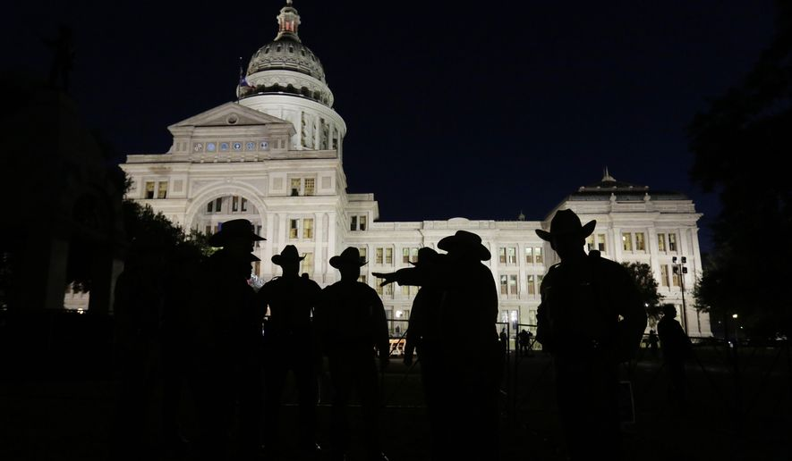 Texas state troopers hold a meeting outside the Texas Capitol prior to the inauguration for Gov.-elect  Greg Abbott, Tuesday, Jan. 20, 2015, in Austin, Texas. (AP Photo/Eric Gay)