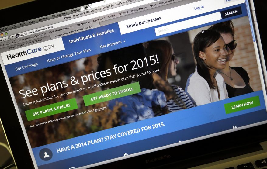 This Nov. 12, 2014, file photo shows the HealthCare.gov website, where people can buy health insurance, on a laptop screen, shown in Portland, Ore. Not only do more Americans have health insurance, but the number struggling with medical costs has dropped since President Barack Obama's health care law expanded coverage, according to a study released Thursday Jan. 15, 2015. (AP Photo/Don Ryan, File)